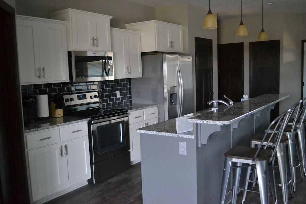 Open concept kitchen fully stocked with all dishes and cookware you need!