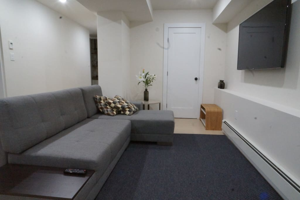 "Seating area with large sofa bed for 2 people and 55"" TV"
