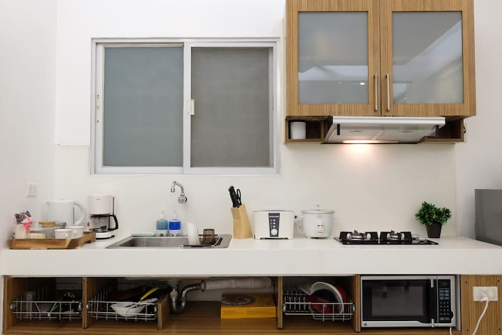 kitchen corner with complete appliances and utensils