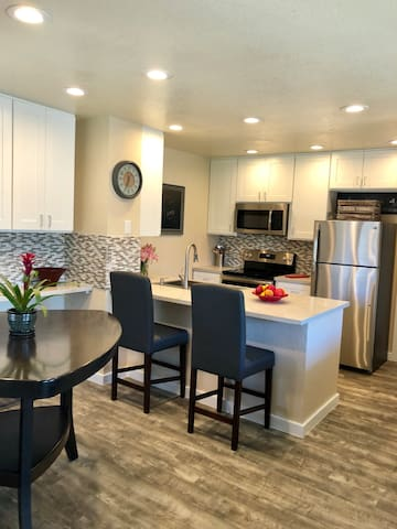 Light & airy kitchen boasts stone counters & all new stainless steel appliances.