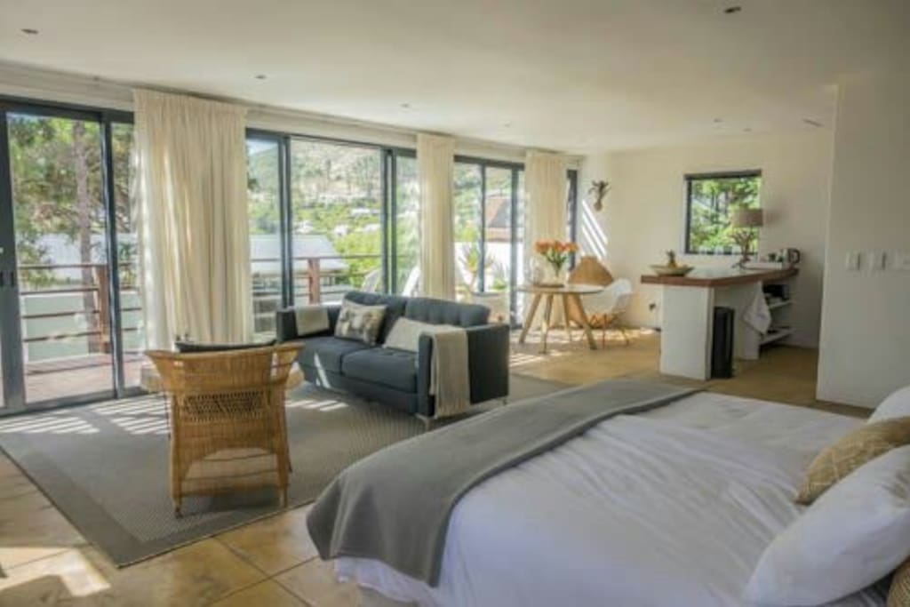 View from bed area with big sliding doors to the balcony.