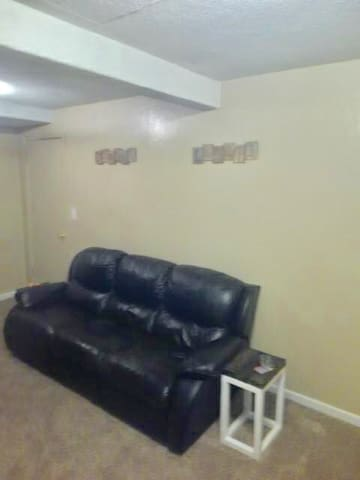 Living area with couch and TV