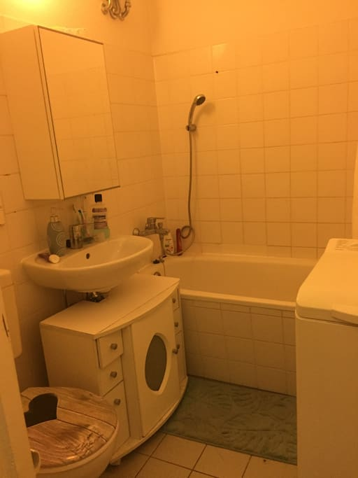 Bathroom with bath and washing machine