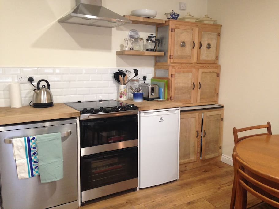The kitchen is a mixture of vintage furniture and modern appliances
