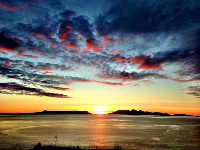 Sunset over the Islands of Eigg & Rhum seen from Arisaig