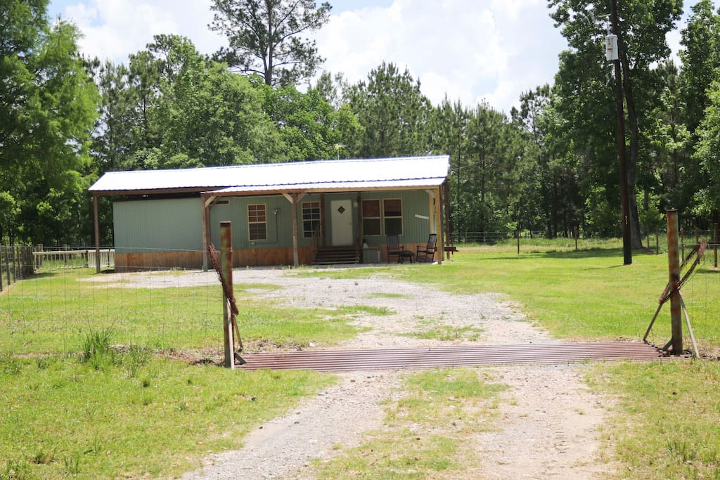 Carport and patio area to park and relax.  Fenced in all the way except for cattle guard to keep the cows out!