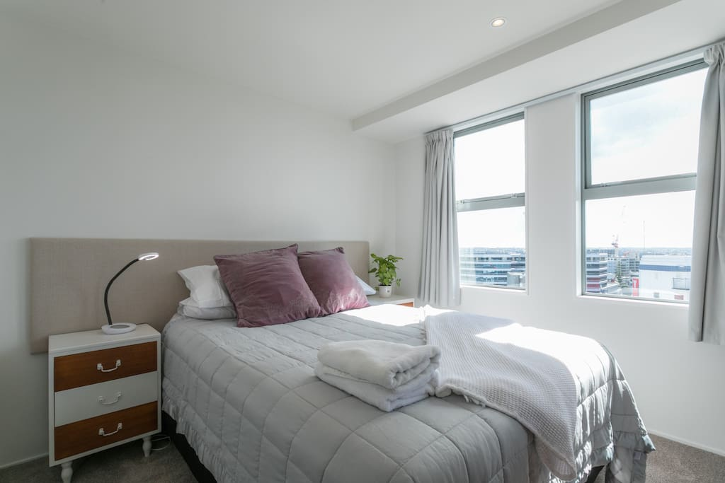 This is the Main bedroom with opening door onto deck and ensuite