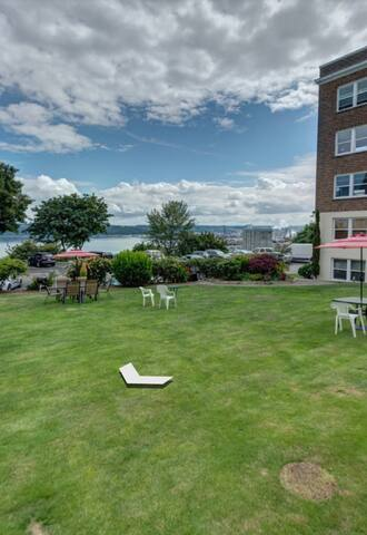 Beautiful lawn and patio area with waterfront views