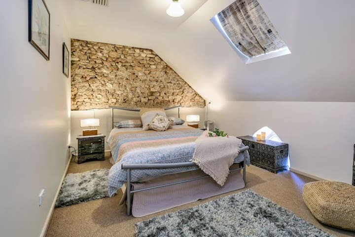 BEDROOM 3 is located upstairs & offers a queen bed, hanging hooks on back of the door, ceiling fan & oil heater.