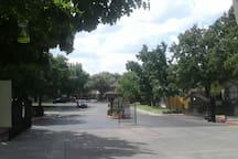 Park on street outside gated entry