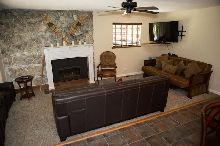 Living room off of the kitchen.  Gas fireplace, wifi with smart tv.  One of the couches turns into a queen bed.