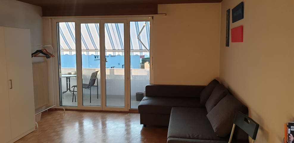 Big room with balcony close to city and airport
