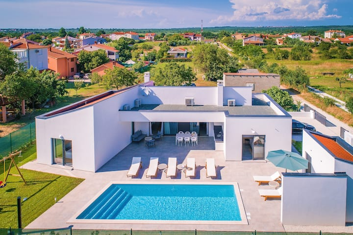 Modern villa with heated pool near the sea