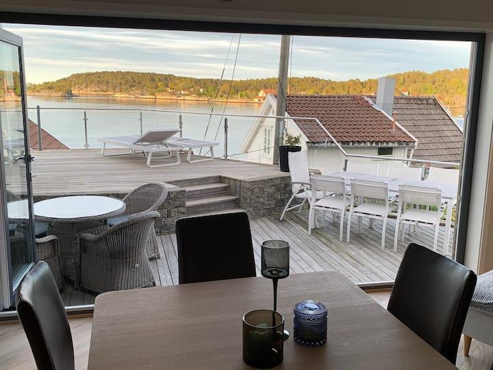 Nybygd leilighet ved sjøen til leie