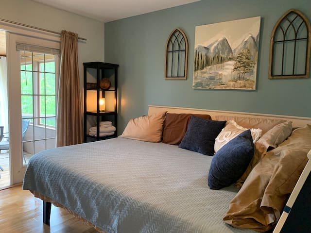 This may be the smallest bedroom in the house, yet it may very well be the best in many respects.  Everybody gets a luxurious space in this place.