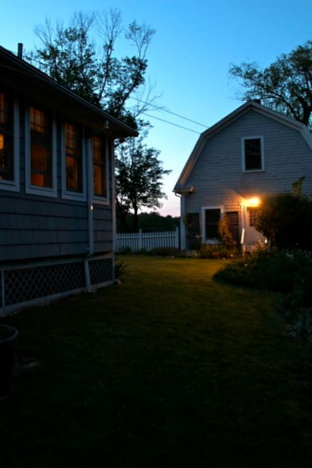 East side of house looking north toward barn at dusk