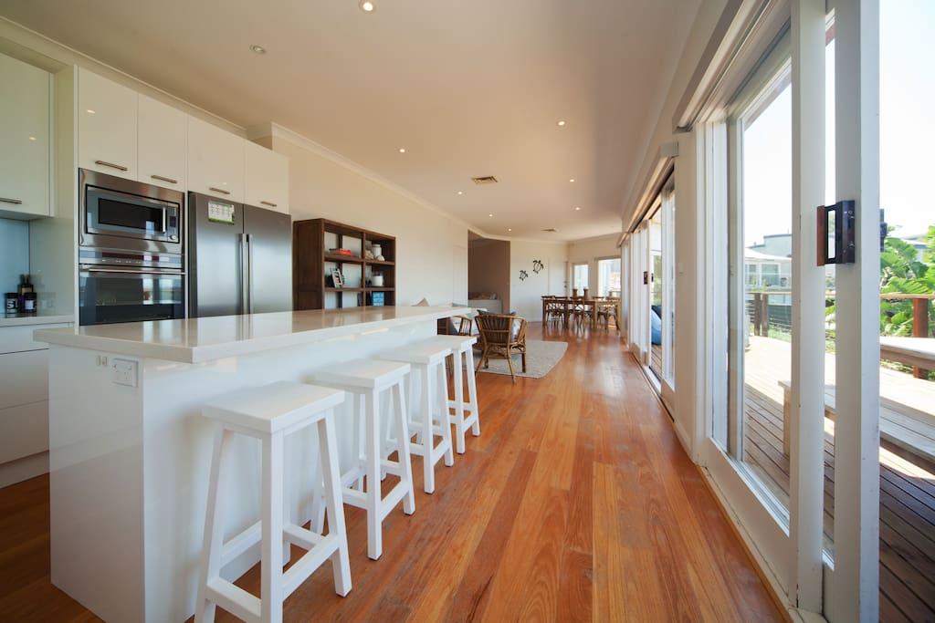 Upstairs open plan kitchen/ lounge/dining opening out onto deck