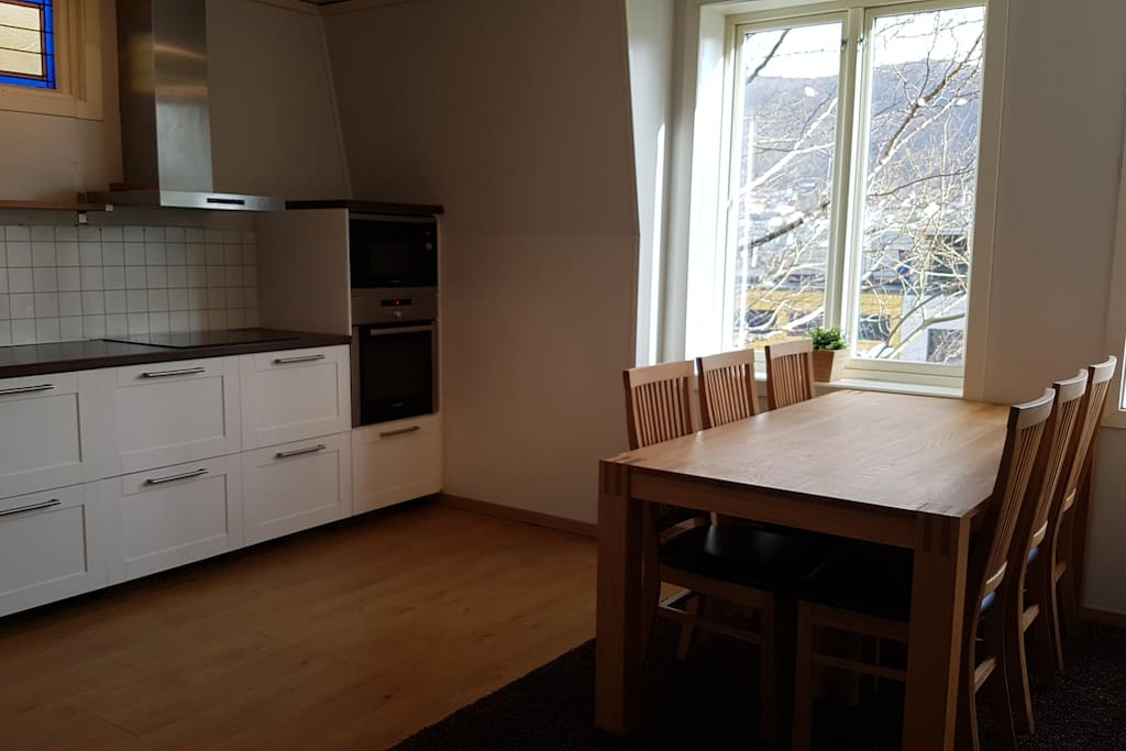 Kitchen with large, extendable dining table. Up to ten people can eat togther here.