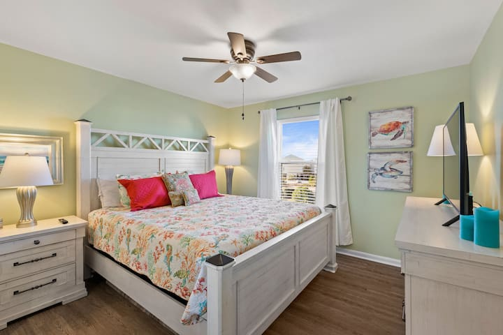 King bed master bedroom with a view