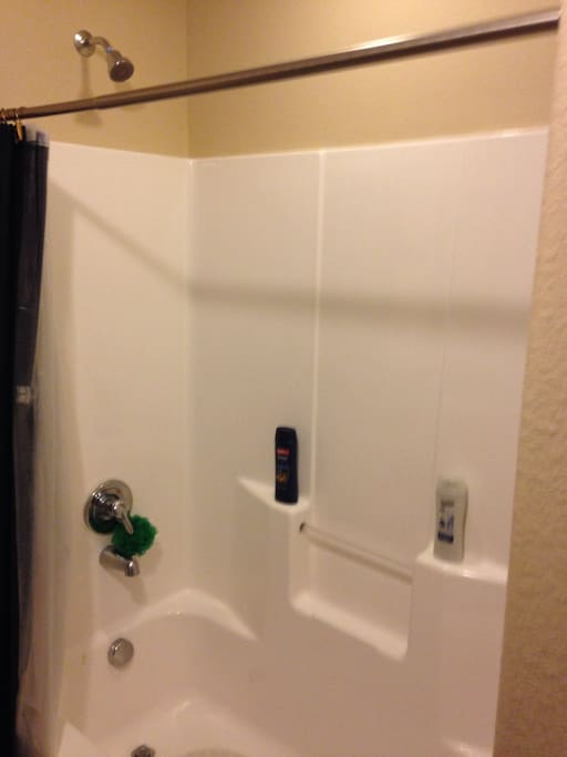 Shared upstairs bathroom with tub/shower combination.