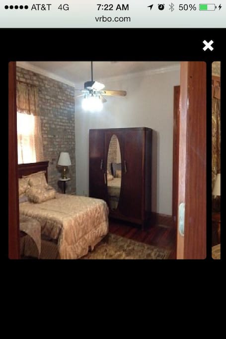 Queen size bed, hard wood flooring, crown molding, 160 year old non working fire place