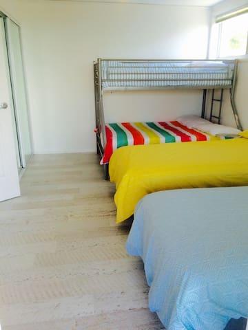 Bedroom 4 - 'kids bedroom'.  Double bunk bed & 2 single beds.