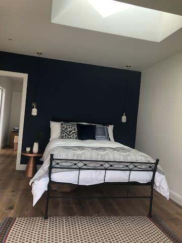 Chic double bedroom with en-suite rain shower.