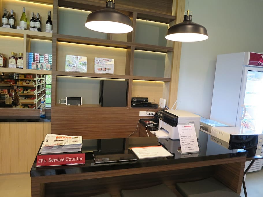 """JP's Service Counter"" in our minimart ""Tasty Selection"" For Check-in/out and Supporting your Stay"