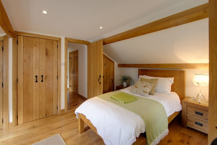 2nd bedroom with built-in wardrobe and door to the corridor leading to the bathroom and to the master bedroom