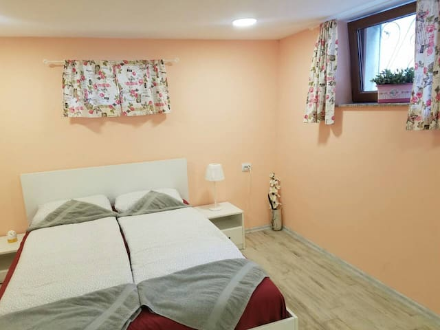 Bedroom- includes 1 bed 140/200, a wardrobe, a cabinet with a hairdryer, an iron