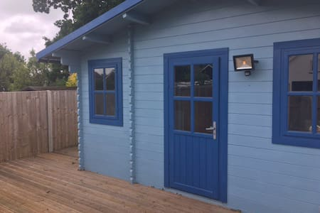 The quaint blue log cabin