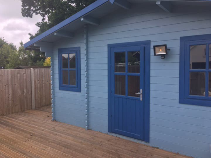 The quaint blue log cabin