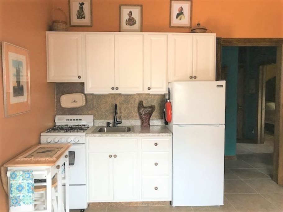 Kitchen area is complete with coffee, tea, and some food to make breakfast with.