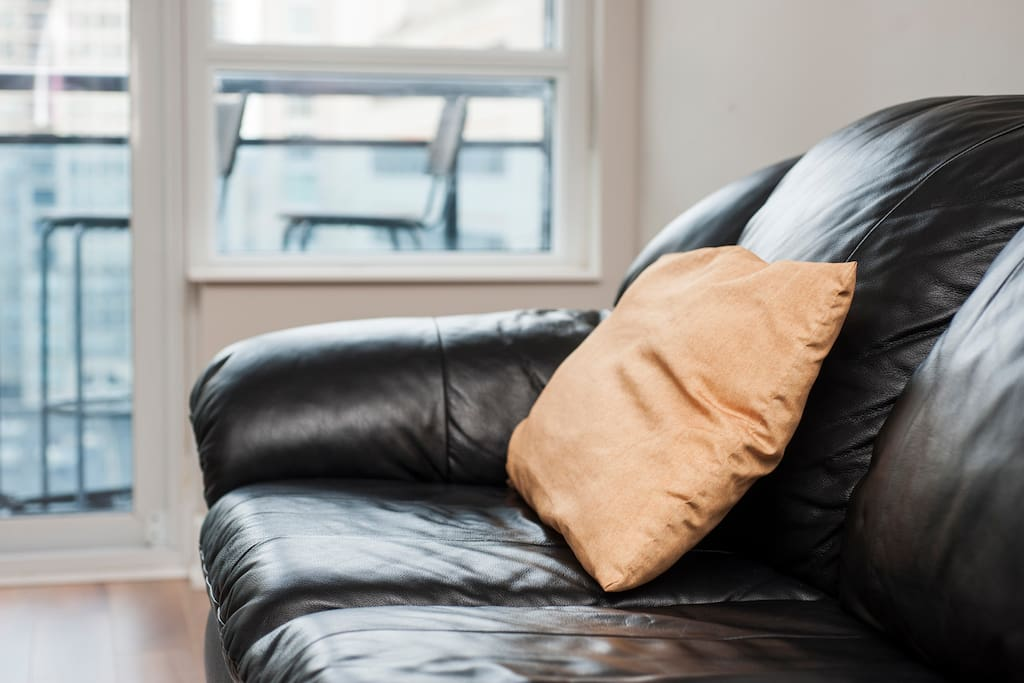 Living room — Comfortable three-seater leather couch.