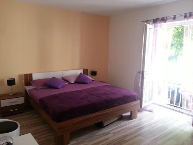 1st bedroom in full purple setting