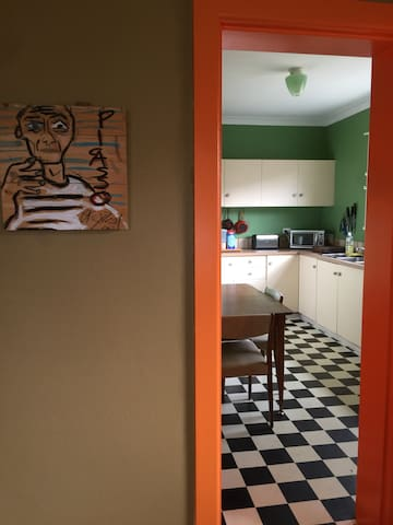 Work from local artist Casey Tosh, view to kitchen
