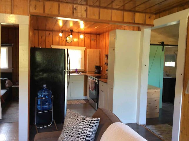 Fully equipped kitchen, has everything you will need to prepare all your meals at home. Full size fridge and stove.