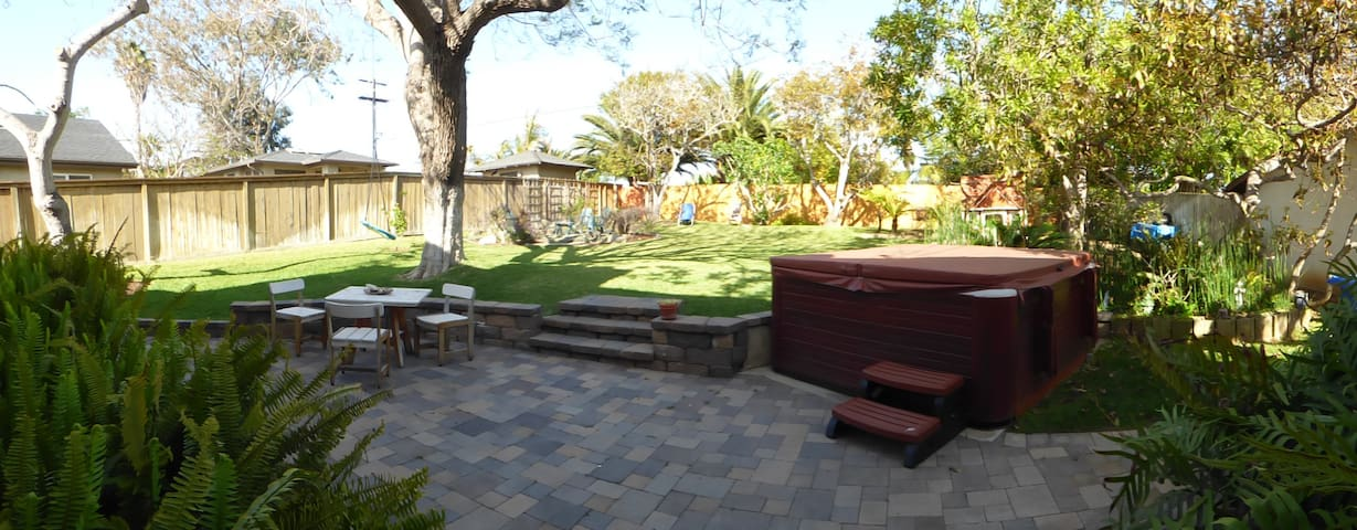 Back yard with jacuzzi