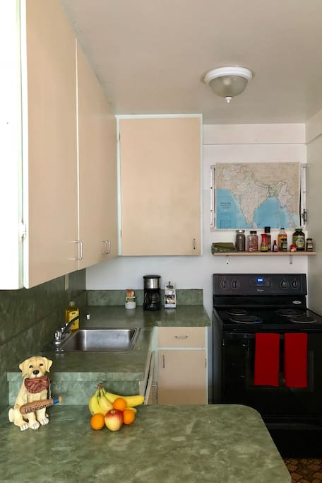 Fully stocked kitchen with stove and refrigerator for your use.