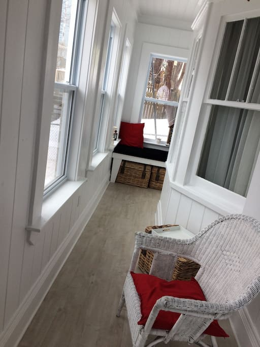 Entrance is a sun porch with built-in nook to curl up with a good book and cup of tea!