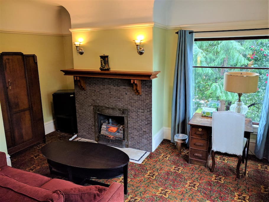 Sitting area with loveseat, electric fireplace and desk