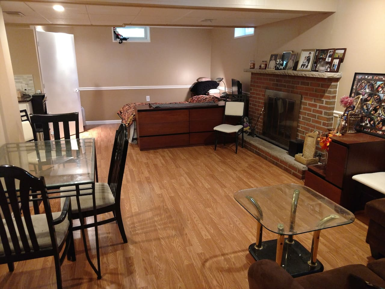 This entire space is yours to rent. It includes private bathroom, kitchen (with utensils, plates, microwave, refrigerator, microwave, garbage disposal, and hot plate), working fireplace, couch, dining table, queen-sized bed, TV with Netflix and HBO Go, WiFi, and private entrance through the garage.