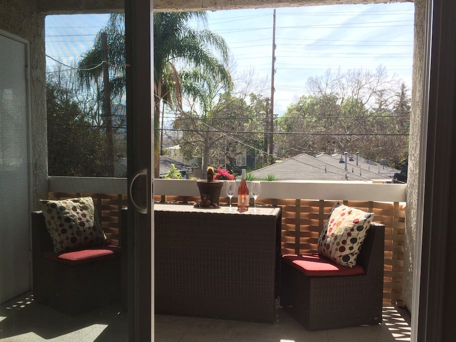 Enjoy breakfast on our balcony with a pleasant view of the Hollywood Hills.