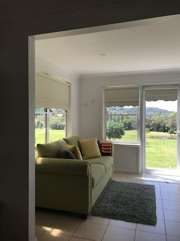 Sunroom is located off the lounge room and has a double sofa bed. Great views of the property.