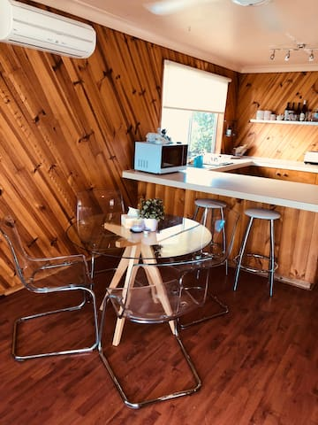 Close to everything- beach!! Nobbys cafes, bars & Shops!! Nice spacious clean house with all amenities- laptop, desk, Netflix, internet all available..