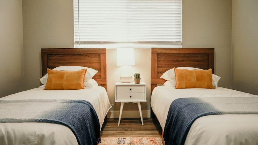 Two twin beds provide guests with enough space to maintain comfort, but enough style to show to your current Instagram following