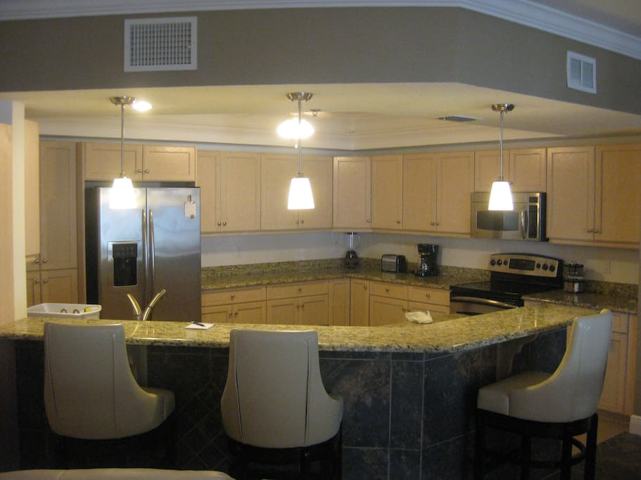 Fully equipped kitchen/breakfast bar  with all essentials for a comfortable stay