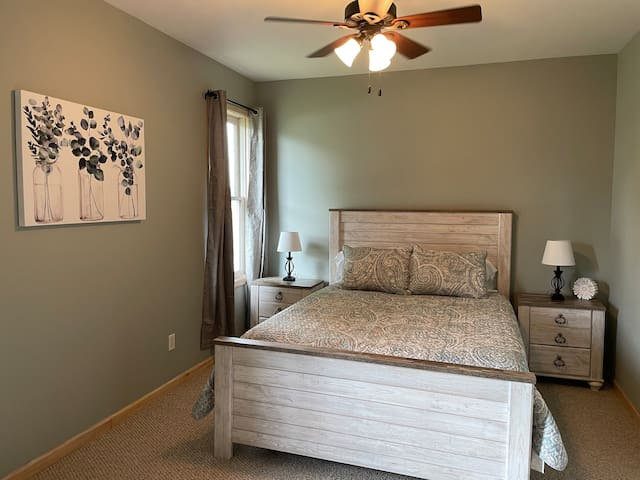 Bedroom 2. Queen bed. Right across from a bathroom. Plenty of drawer space & a closet. Smart TV.