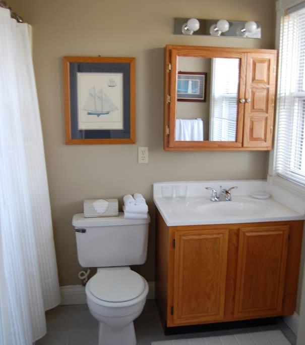 En suite bath with tub/shower unit.