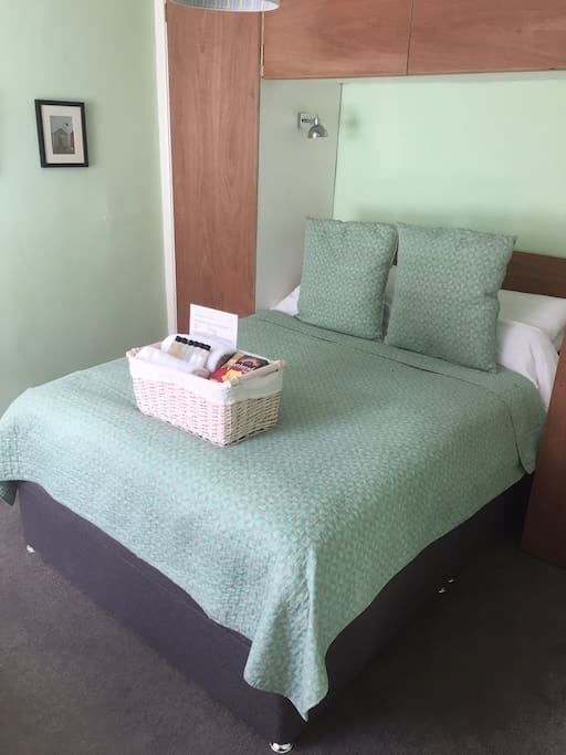 Comfy double bed with welcome basket and professionally laundered bedding and towels